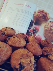Stack of Muffins in front of cookbook