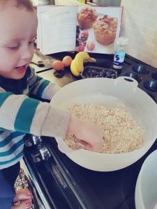 Little boy mixing ingredients