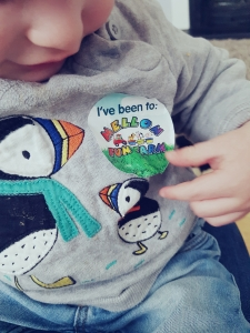 Little Boy wearing an 'I've been to Mellon Fun Farm' sticker