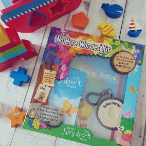Flatlay of no more worries kit surrounded by colourful kids toys
