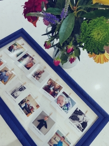 Flatlay of blue picture frame with flowers in jug